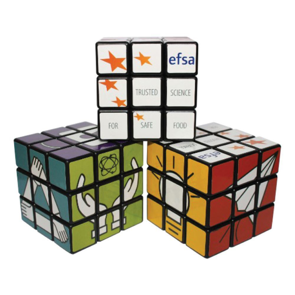 three rotating puzzle cubes stacked each with a full colour design to each different side