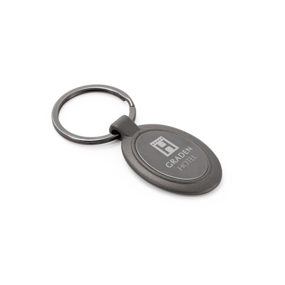 oval metal keyring in a dark grey metal with branding to the centre