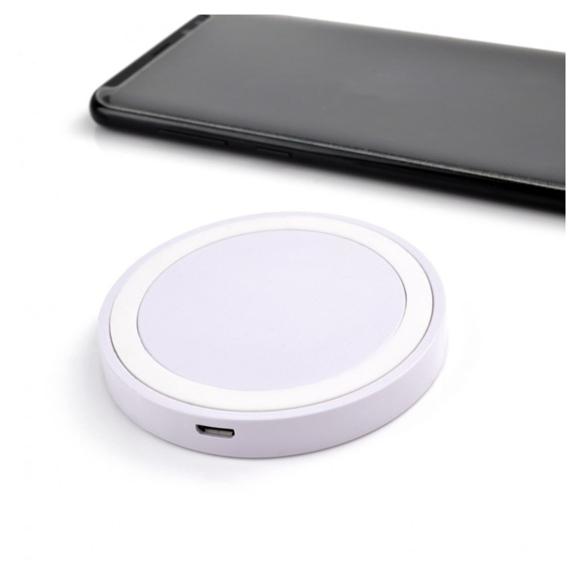 Round white wireless charging pad