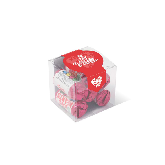 Love heart sweet rolls in a small clear cube sealed with a printed label