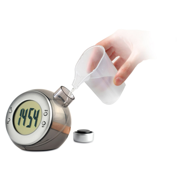 water powered mini desk clock with digital screen being topped up with water