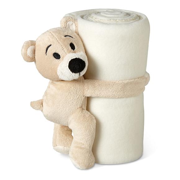 teddy bear holding cream blanket