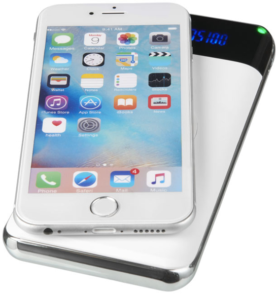 White power bank wirelessly charging a phone