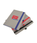 A5 grey PU ashurst notebook with coloured edge paper, elastic pen loop and closure strap in blue red and black. 2 colour print logo