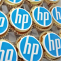 Iced cupcakes with personalised toppers printed with a company logo