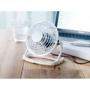 white mini fan on a desk