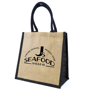 Natural jute bag with company logo printed to the front, black coloured gusset and handles