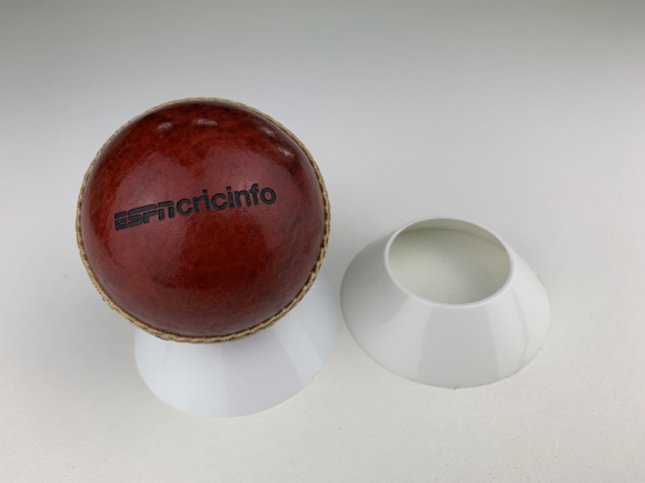 Full Size Leather Cricket Ball in Burgundy Colour. Supplied With Stand.