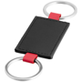 black leather look rectangle with a keyring loop to both short sides and red loops