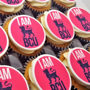 Branded cupcakes with a logo printed on the top