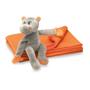 hippo toy sitting on orange fleece