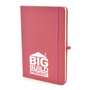 A5 soft touch notebook in pink with colour match ribbon, elastic closure strap and pen loop with 1 colour white print logo