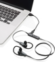 Bluetooth earbuds plugged into charge on laptop