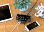 wireless power bank charging a tablet and mobile phone