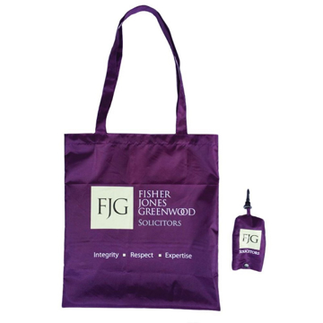Purple long handled foldable shopping bag with storage pouch, both branded with a company logo.