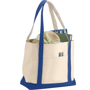 Natural heavy weight cotton bag with blue trim filled with shopping and pens in front pocket