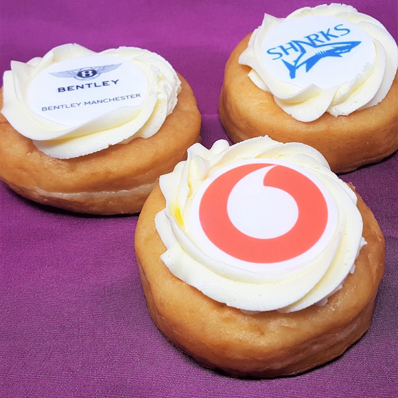 frosted doughnuts with icing topper branded with a company logo