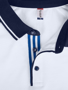 Pittsford Polo Shirt in White With Navy Details Close Up of Front Buttons