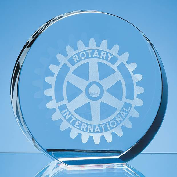 Round crystal paper weight with a graphic engraved on the front
