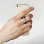 Custom shape acrylic phone ring being held with ring
