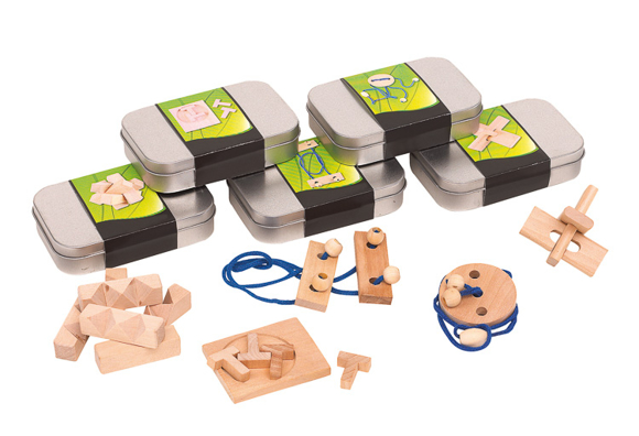 a selection of tins with a full colour branded paper wrap each containing a random mix of wooden puzzle games