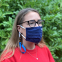 Face Mask Strap in blue with mask attached and worn round neck with mask on