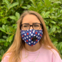 woman wearing face mask with valve with a star print front view