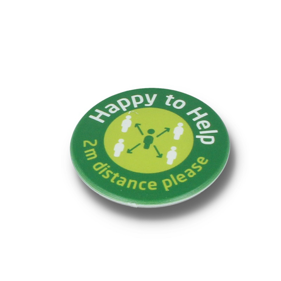 round green badge promoting social distancing