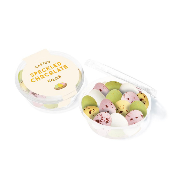 a small transparent pot of speckled chocolate eggs with branding to the lid