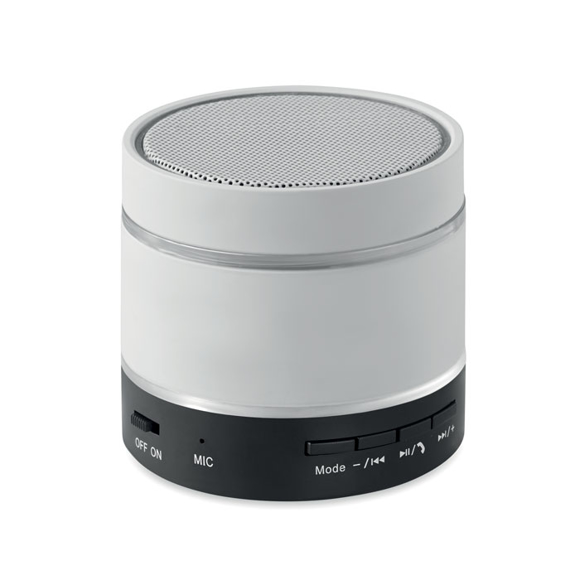 a white round bluetooth speaker with a silver trim