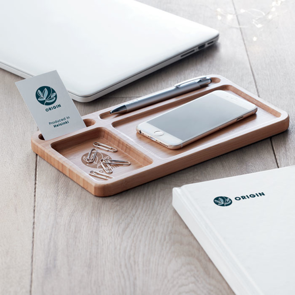 a bamboo desktop organiser filled with stationery and wireless charger