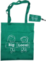 Green long handled foldable shopping bag with storage pouch, both branded with a company logo.